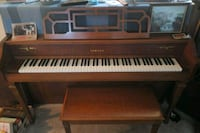brown and white upright piano 40 km