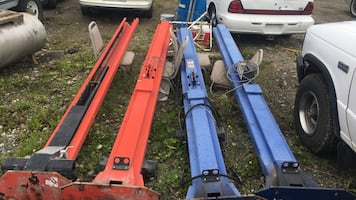 Two blue and red car and truck lifts