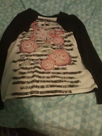 white, black, and pink floral sweater