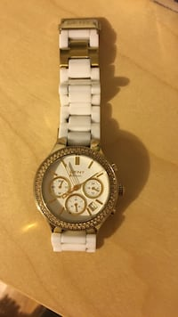 Gold and white DKNY watch (small crack on the bracelet)  Montréal, H2L 1R1