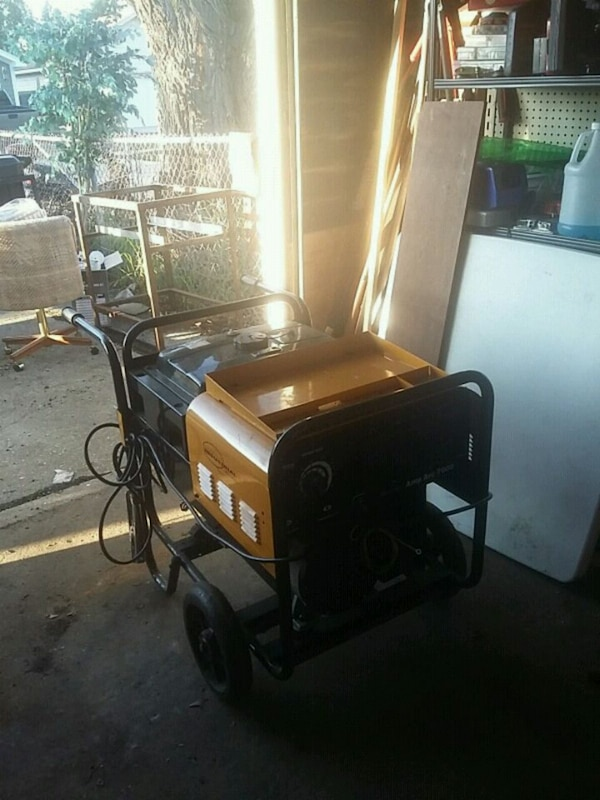black and yellow reel mower