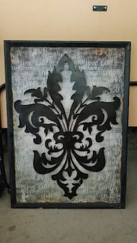 black fleur de lis illustration with black frame