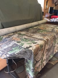 Rolls of camo material great for building blinds and hunting clothes.