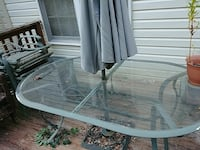 oval glass-top patio table with metal base Laurel, 20723