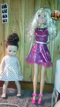 two girl in pink and white dress dolls Powell, 37849