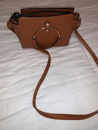 Brown super cute cross body gold detailing and perfect size purse!! Attleboro, 02703