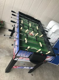 green and black foosball table