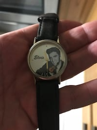 Elvis Presley collectors commemorative anniversary watch!! Cute little guitar moves around Elvis as the second hand timer !!! Classic!
