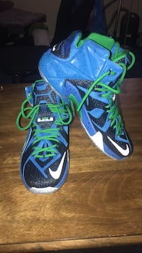 pair of blue-and-green Nike basketball shoes Washington, 20020