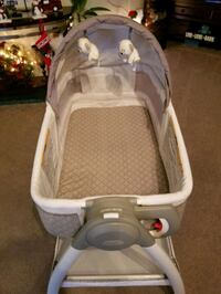 Bassinet and changing table in one