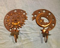 two bronze-colored sun and moon candle sconces Calgary, T2W 3T9