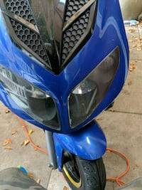 blue and black motor scooter Toronto, M5G