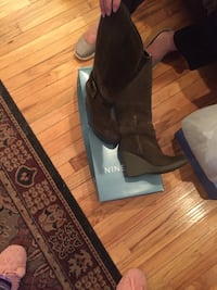 Mossy green suede boots with wedge heel and buckle that  Nine West