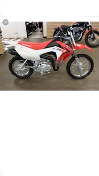 White and red honda crf dirt bike Anderson, 46011