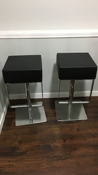 two square faux black leather padded bar stools. Vancouver, V5L 1Z8