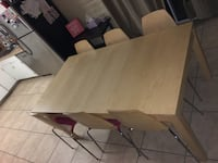Dining table w/ 6 matching chairs. Extendable with an extra part to make the table longer.