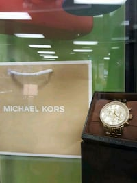 round silver-colored Michael Kors analog watch wit