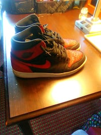 pair of red-and-black Nike basketball shoes Mobile, 36608