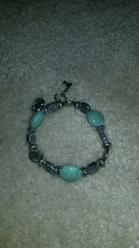 silver-colored and blue stone bracelet