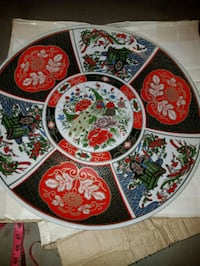 white, red, and green floral ceramic plate