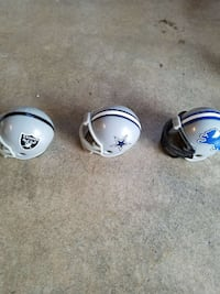 three white and gray football helmets Anderson, 46013