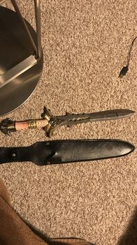 black fantasy dagger with black leather scabbard