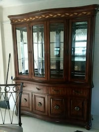 brown wooden framed glass china cabinet Columbus