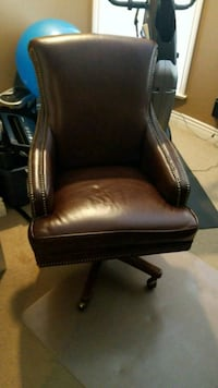 black leather padded brown wooden armchair Vancouver, V6R 3M5