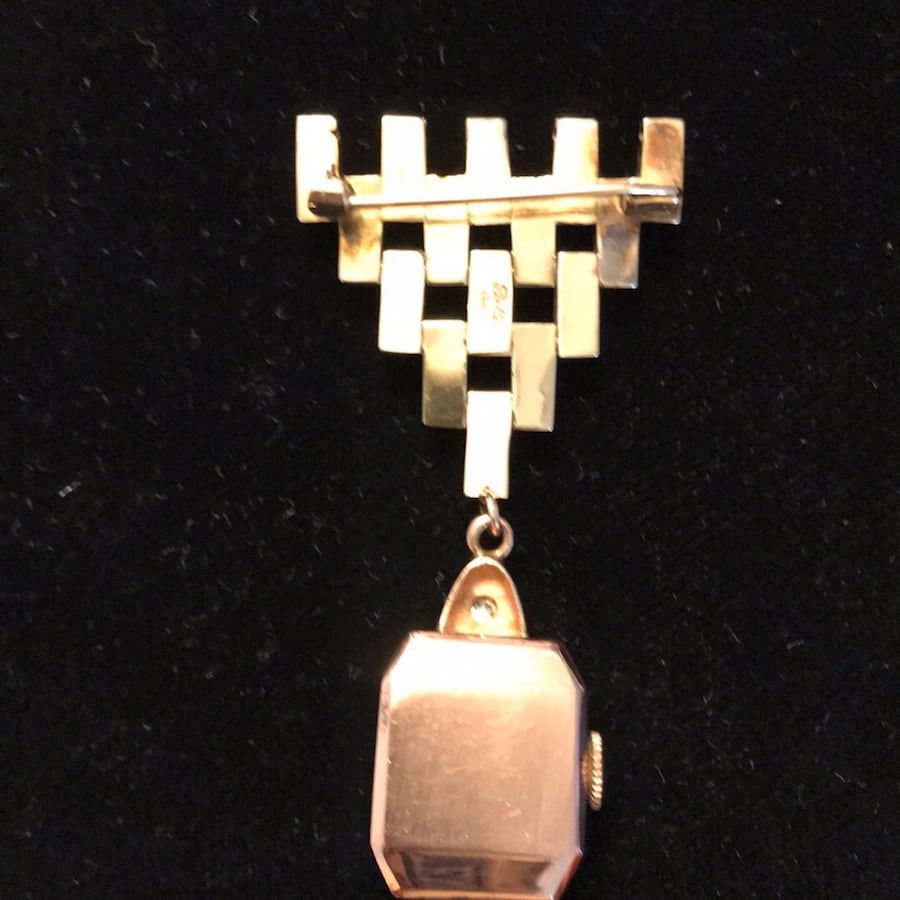Gold-colored watch pendant
