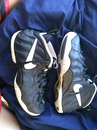pair of black-and-white Nike Foamposite Washington, 20011