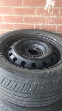 Black bullet hole car wheel with tire Mississauga, L5T 2S4