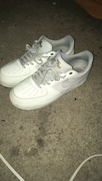 pair of white Nike Air Force 1 low Houston, 77084