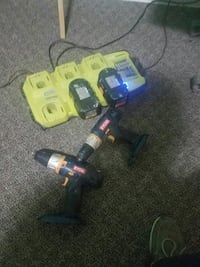 two Ryobi cordless power drills with lithium chargers