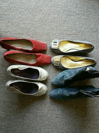4 pairs of womens shoes. Different sizes Clinton, 20735