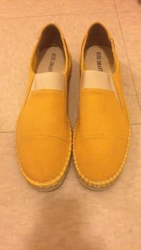 pair of yellow Miss Smart slip-on shoes