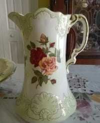 beige, brown, and red floral ceramic pitcher