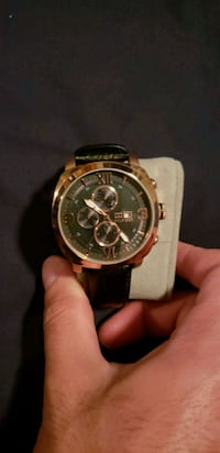 round gold chronograph watch with black leather strap Whitby, L1N 0H4