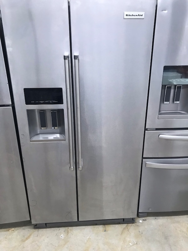 stainless steel side by side refrigerator with dispenser 1e2909ed-3f7d-41d6-8030-9d20a41cbf3e