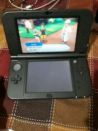 Ds XL with Pokemon ultra sun.  Toronto, M1E 2Y2