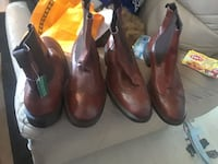 two pairs of brown and black leather cowboy boots Toronto, M9N 3S3