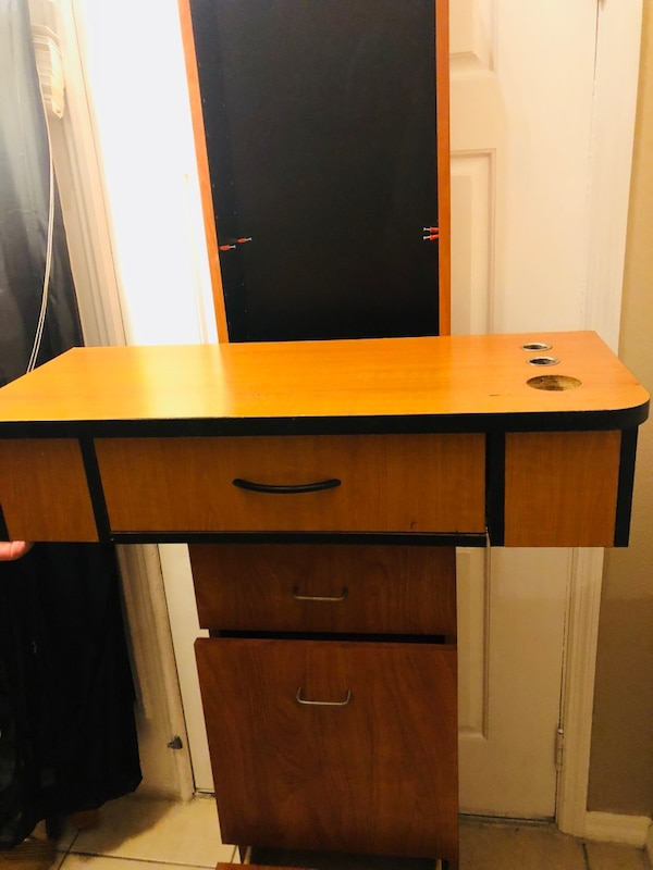brown and black wooden cabinet