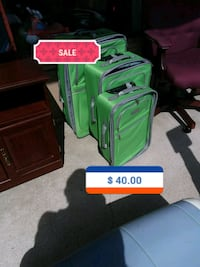 green and black luggage bag Saint Charles, 63301