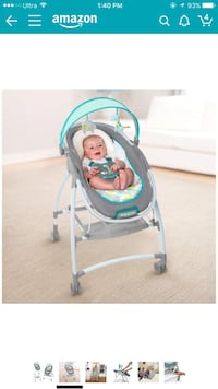 Baby's gray and white cradle and swing 213 mi