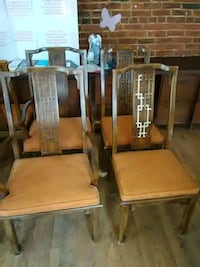 two brown wooden chairs with brown pads Hagerstown, 21740