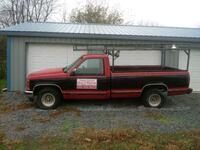 red and black single cab pickup truck Hagerstown, 21740