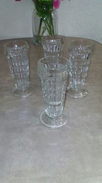four clear glass candle holder