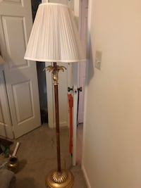 white floor lamp with brown and gold steel base