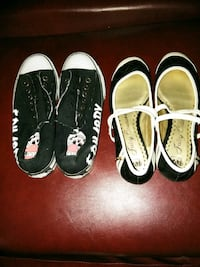 two pairs of black and white Vans low top sneakers Milwaukee, 53218
