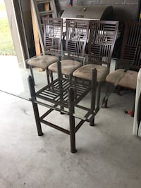 Brown glass top table with 4 matching chairs in good condition OBO