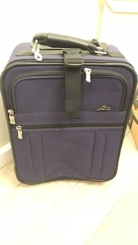 Dark blue/purple carry-on rolling suitcase - great condition!